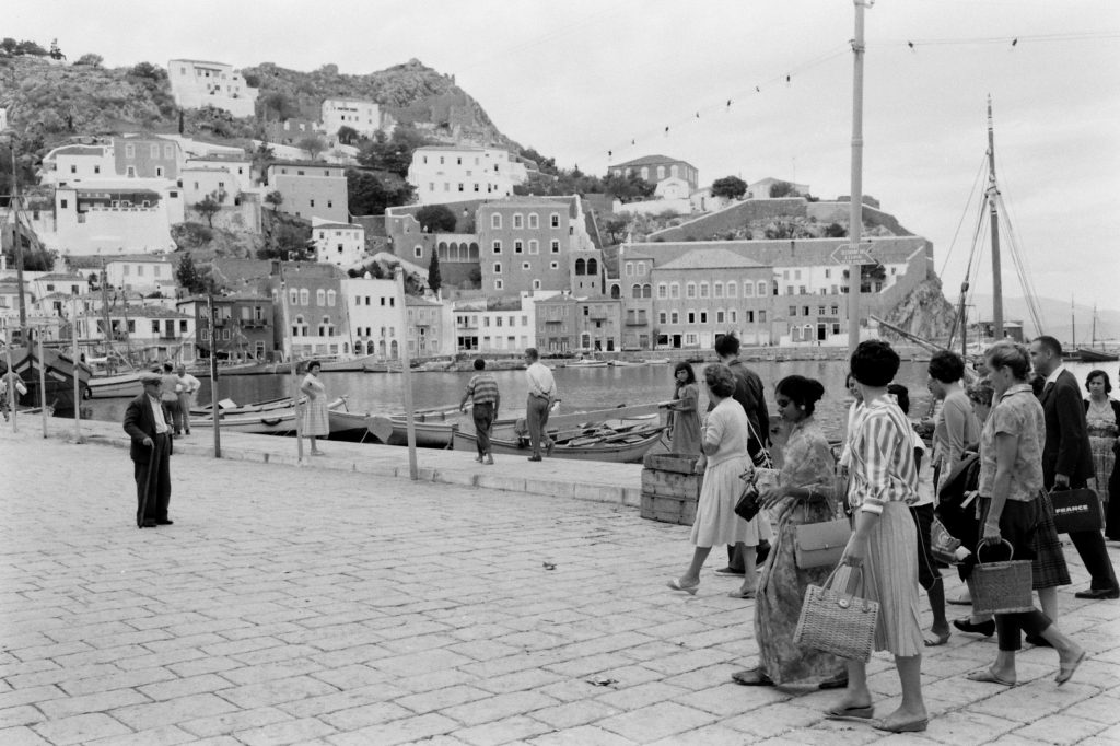 People walking along the shore of Hydra, Greece. (Photo by James Burke/The LIFE Picture Collection © Meredith Corporation)
