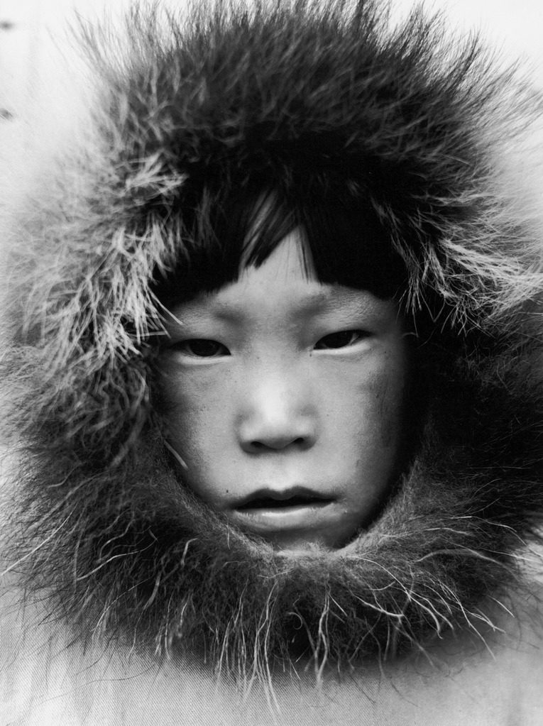 Closeup portrait of an Eskimo child in Tuktoyaktuk, Canada. (Photo by Margaret Bourke-White/The LIFE Picture Collection © Meredith Corporation)