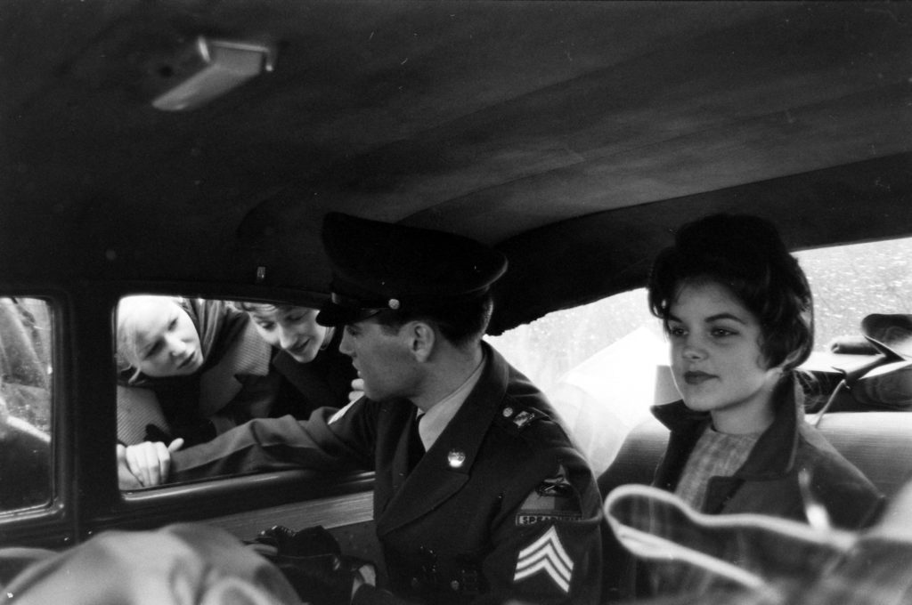 Elvis and Priscilla leave the house he and his family occupied in Bad Nauheim, Germany. (Photo by James Whitmore/The LIFE Picture Collection © Meredith Corporation)