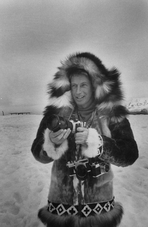 Stan Wayman with his camera taking photos of a Walrus hut. (Photo by Stan Wayman/The LIFE Picture Collection © Meredith Corporation)