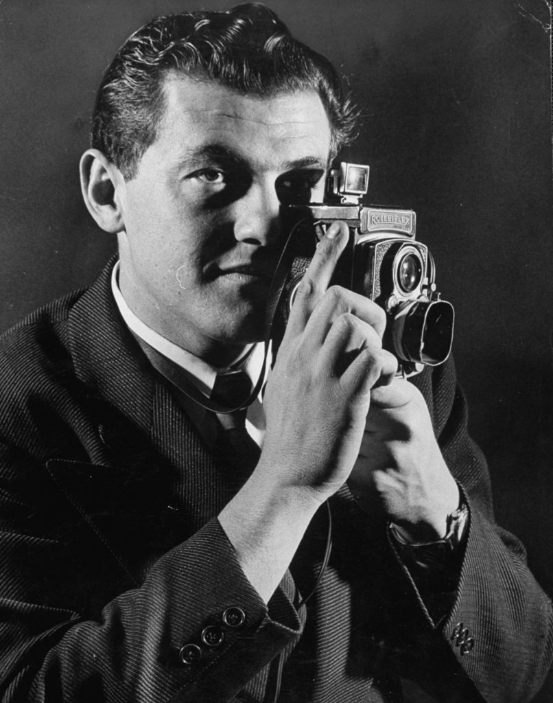 Hank Walker with his camera. (Photo by Wallace Kirkland/The LIFE Picture Collection © Meredith Corporation)