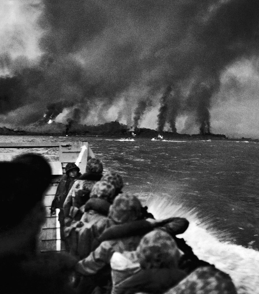 US Marines crouched in landing boat, looking at the bombardment of the beach where they are about to land. (Photo by Hank Walker/The LIFE Picture Collection © Meredith Corporation)