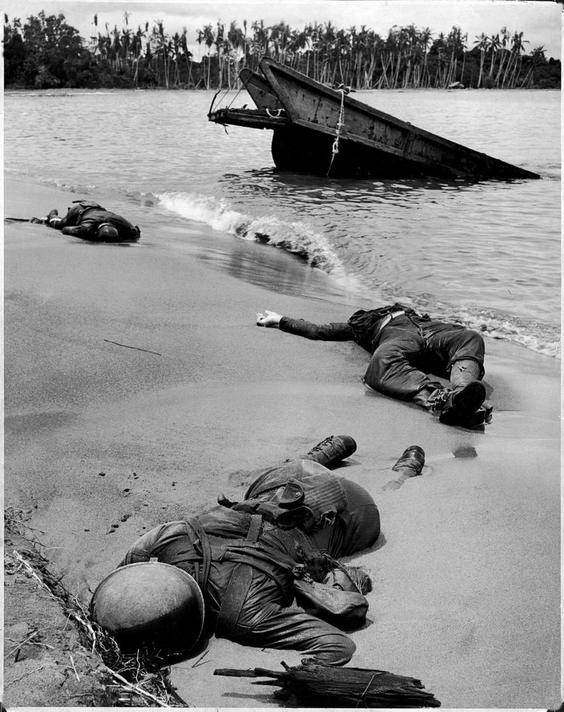 Three dead Americans, killed during the fight to take Buna Beach from the occupying Japanese forces, Papua New Guinea, 1943. (Photo by George Strock/The LIFE Picture Collection © Meredith Corporation)