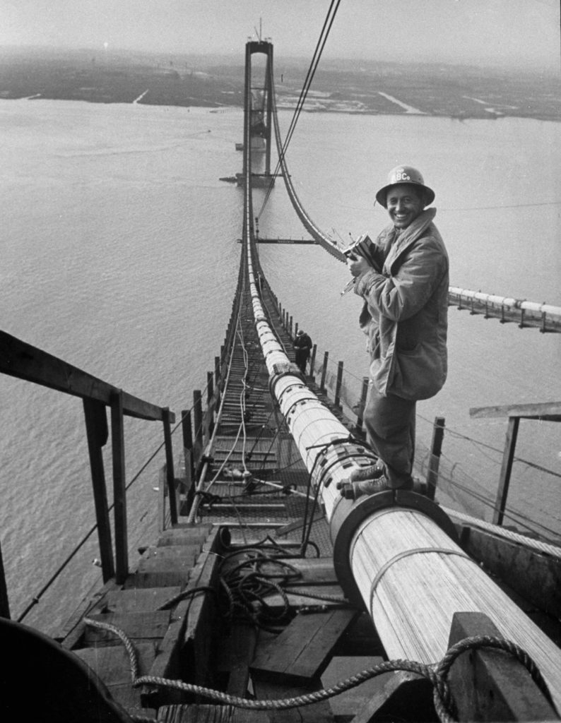 Peter Stackpole with his camera standing on a suspension cable as he covers the construction of the Delaware Memorial Bridge. (Photo by Peter Stackpole/The LIFE Picture Collection © Meredith Corporation)