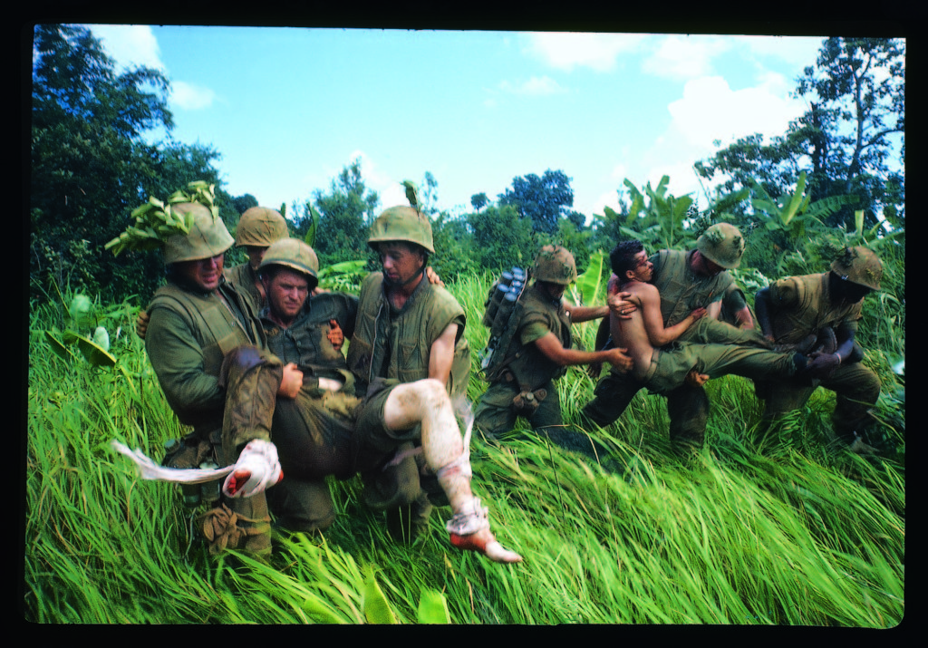 Members of 1st Marine Division carrying their wounded during the Vietnam War, 1966. (Photo by Larry Burrows/The LIFE Picture Collection © Meredith Corporation)