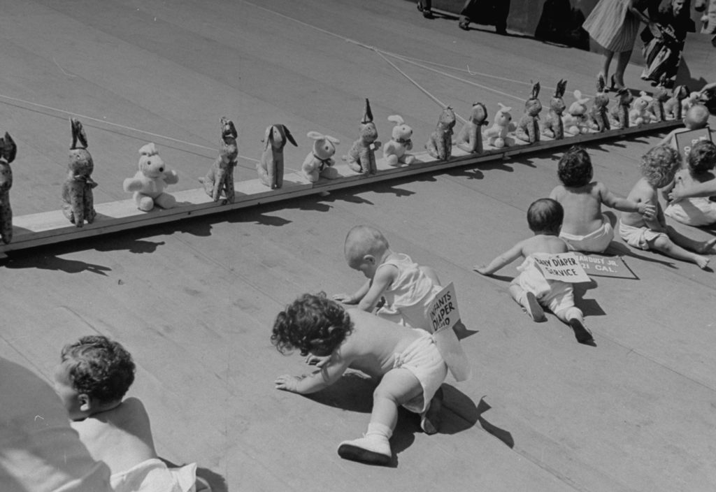 Babies crawling during the 8th annual Diaper Service Derby sponsored by the National Institute of Diaper Services. (Photo by Cornell Capa/The LIFE Picture Collection © Meredith Corporation)