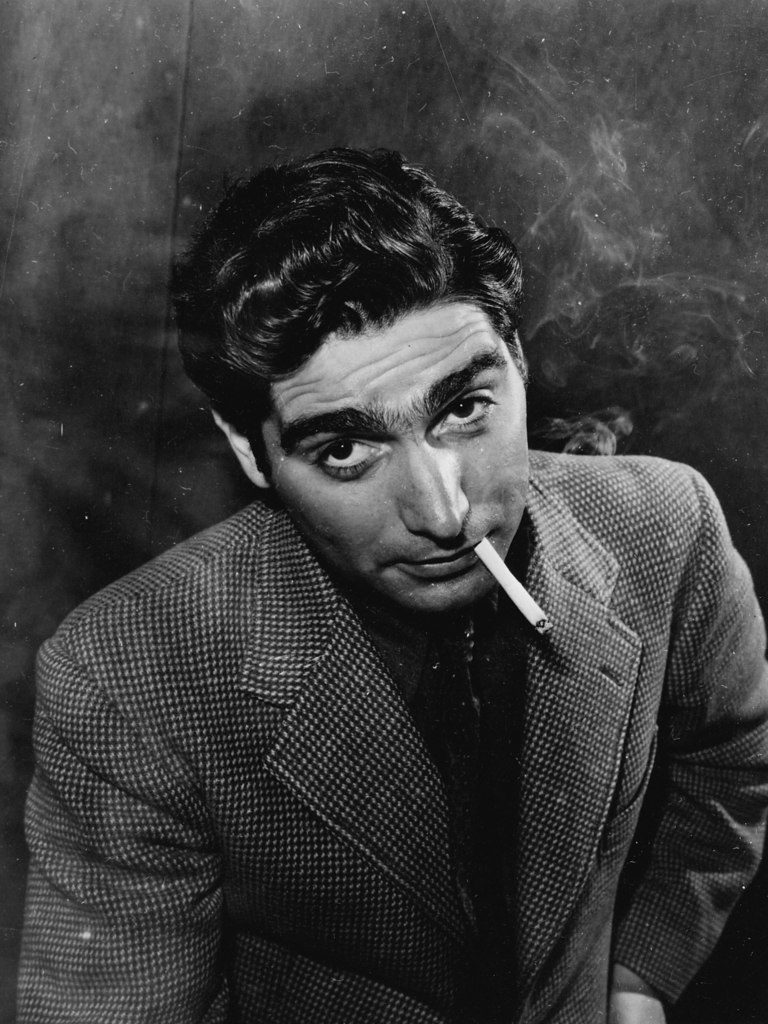 Portrait of Robert Capa smoking cigarettes. (Photo by Alfred Eisenstaedt/The LIFE Picture Collection © Meredith Corporation)