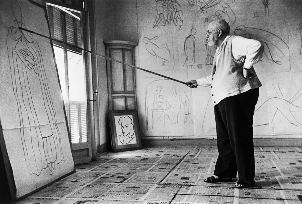 Painter Henri Matisse using a bamboo pole tipped with charcoal to draw a half-scale figure of St. Dominic. (Photo by Robert Capa/The LIFE Images Collection)