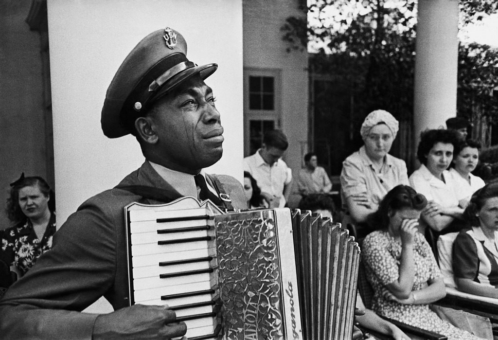 Navy CPO Graham Jackson crying as he plays 'Goin' Home' on the accordion at President Franklin D. Roosevelt's funeral. (Photo by Edward Clark/The LIFE Picture Collection © Meredith Corporation)