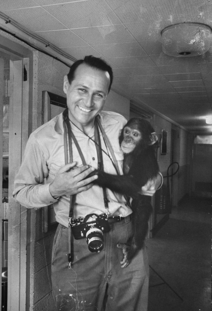 Portrait of Ralph Crane with his camera and a trained space chimpanzee. (Photo by Ralph Crane/The LIFE Picture Collection © Meredith Corporation)