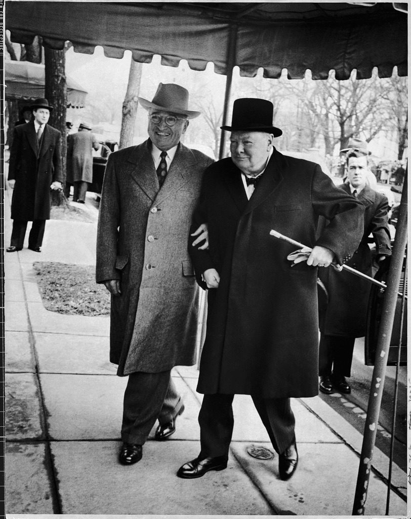 President Harry Truman walking arm-in-arm w. British Prime Minister Winston Churchill as he arrives at Blair House for his visit to discuss foreign affairs. (Photo by George Skadding/The LIFE Picture Collection © Meredith Corporation)