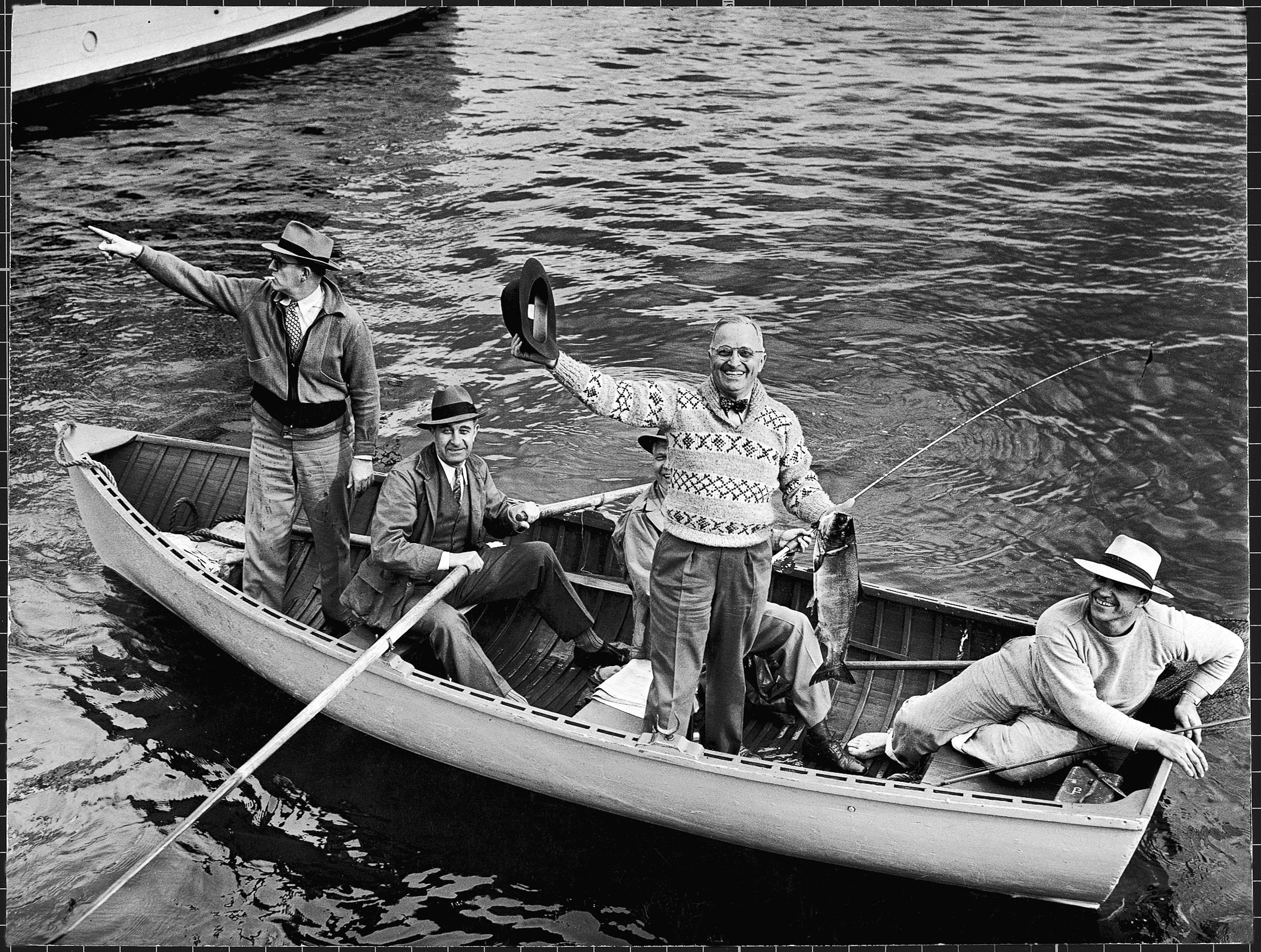President Harry S. Truman waving his hat as he holds up a king salmon while fishing with others on Puget Sound. (Photo by George Skadding/The LIFE Picture Collection © Meredith Corporation)