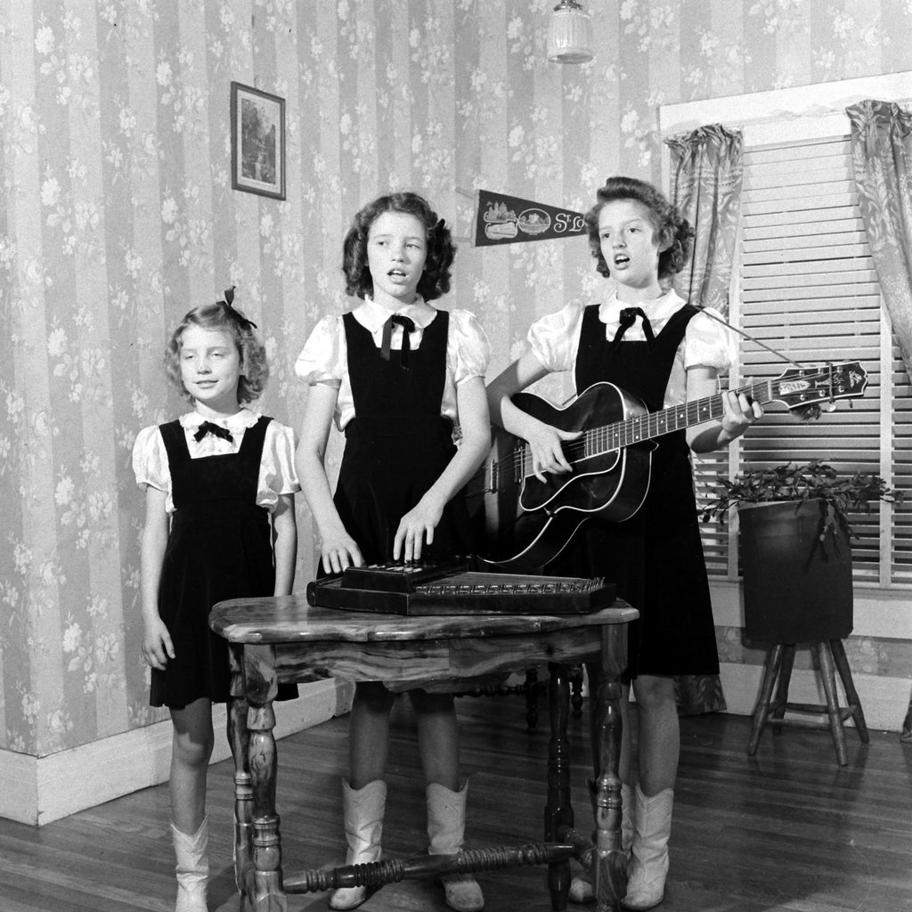 Sisters playing music together. (Photo by Eric Schaal/The LIFE Picture Collection © Meredith Corporation)