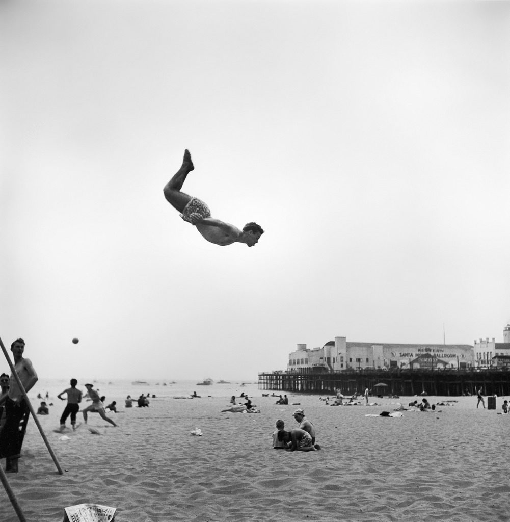 A man flying off a trampoline at Santa Monica Beach. (Photo by Loomis Dean/The LIFE Picture Collection © Meredith Corporation)