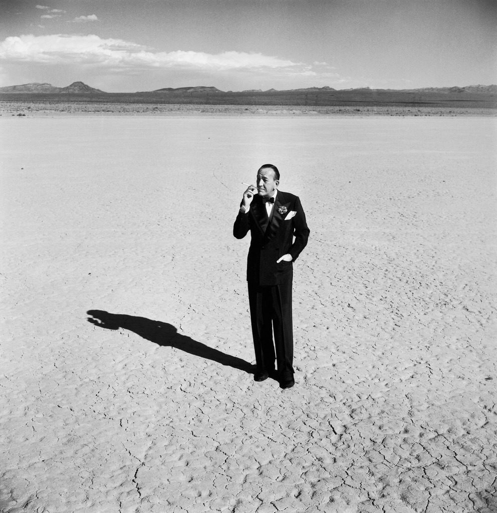 British entertainer Noel Coward in middle of desert, dressed for his nightclub act. (Photo by Loomis Dean/The LIFE Picture Collection © Meredith Corporation)