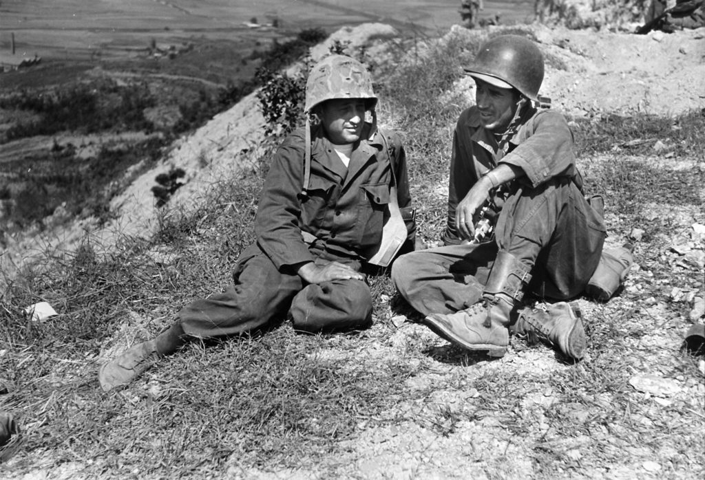Photographers Carl Mydans (L) and David Douglas Duncan (R) relaxing during a lull in the Korean war. (Photo by Carl Mydans /The LIFE Images Collection)