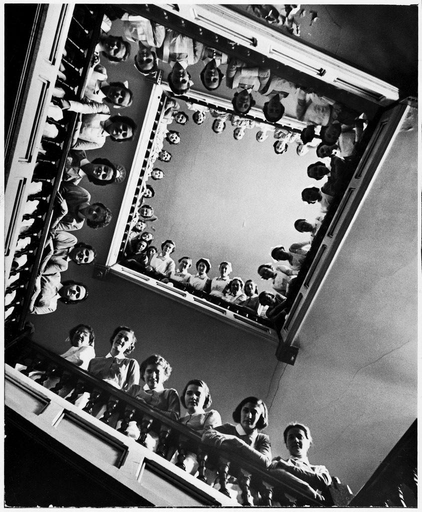 Student nurses lining the railings of a stairwell at Roosevelt hospital. (Photo by Alfred Eisenstaedt/The LIFE Picture Collection © Meredith Corporation)