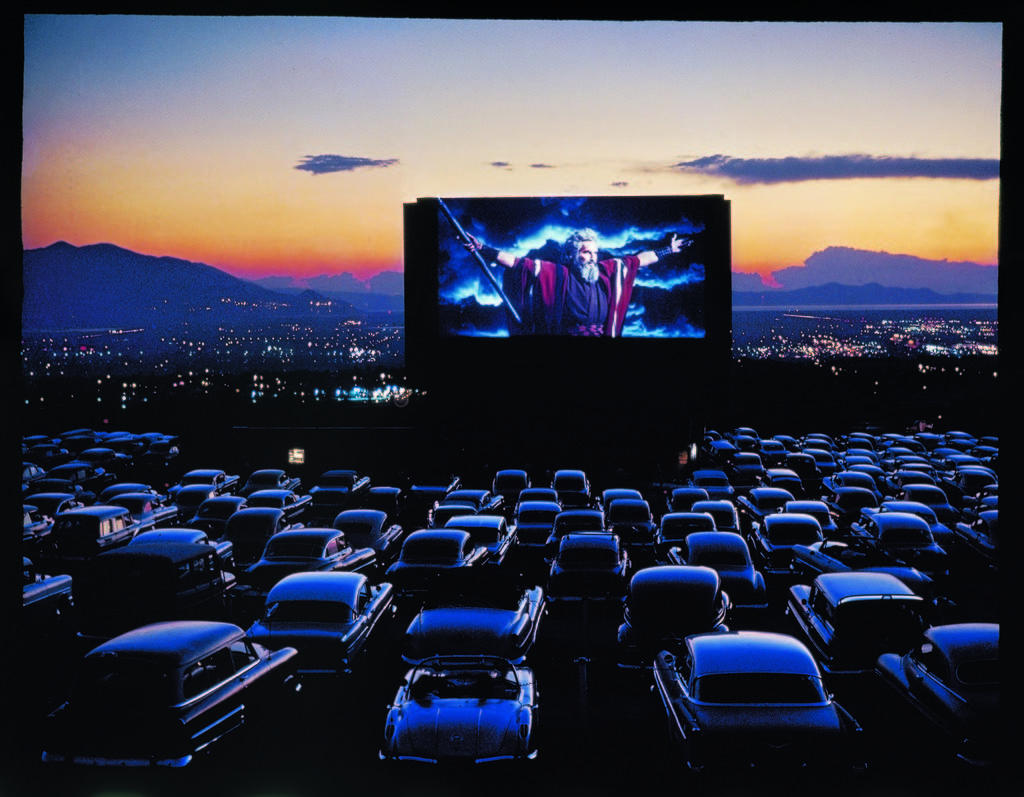 """Actor Charlton Heston as Moses with his arms flung wide while appearing in the motion picture, """"The Ten Commandments"""", as it is shown at drive-in movie theater. (Photo by J.R. Eyerman/The LIFE Picture Collection © Meredith Corporation)"""