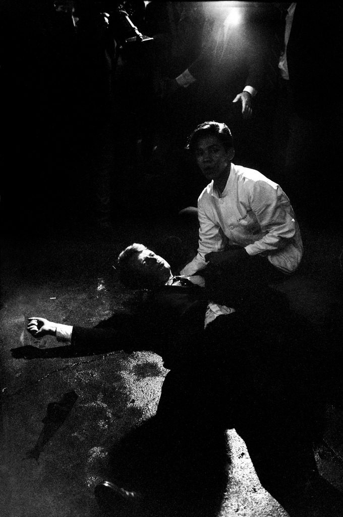 Senator Robert Kennedy sprawled semiconscious in his own blood on floor after being shot in the brain and neck by Sirhan Sirhan while a busboy Juan Romero tries to comfort him. (Photo by Bill Eppridge/The LIFE Picture Collection © Meredith Corporation)