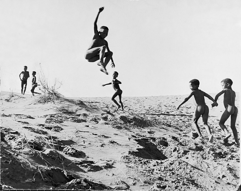 Bushman children playing games on sand dunes.(Photo by N.R. Farbman/The LIFE Picture Collection © Meredith Corporation)