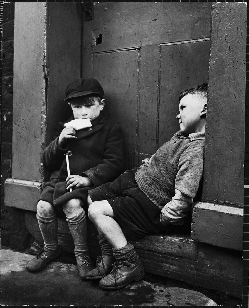 Two boys sitting on doorstep. (Photo by N.R. Farbman/The LIFE Picture Collection © Meredith Corporation)