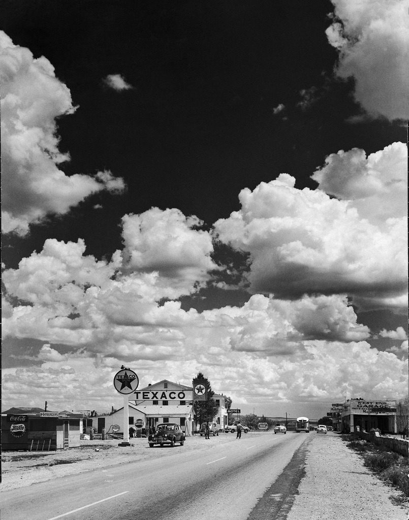 Dramatic cumulus clouds billowing over a Texaco gas station along a stretch of highway US 66, aka Route 6. (Photo by Andreas Feininger/The LIFE Picture Collection © Meredith Corporation)