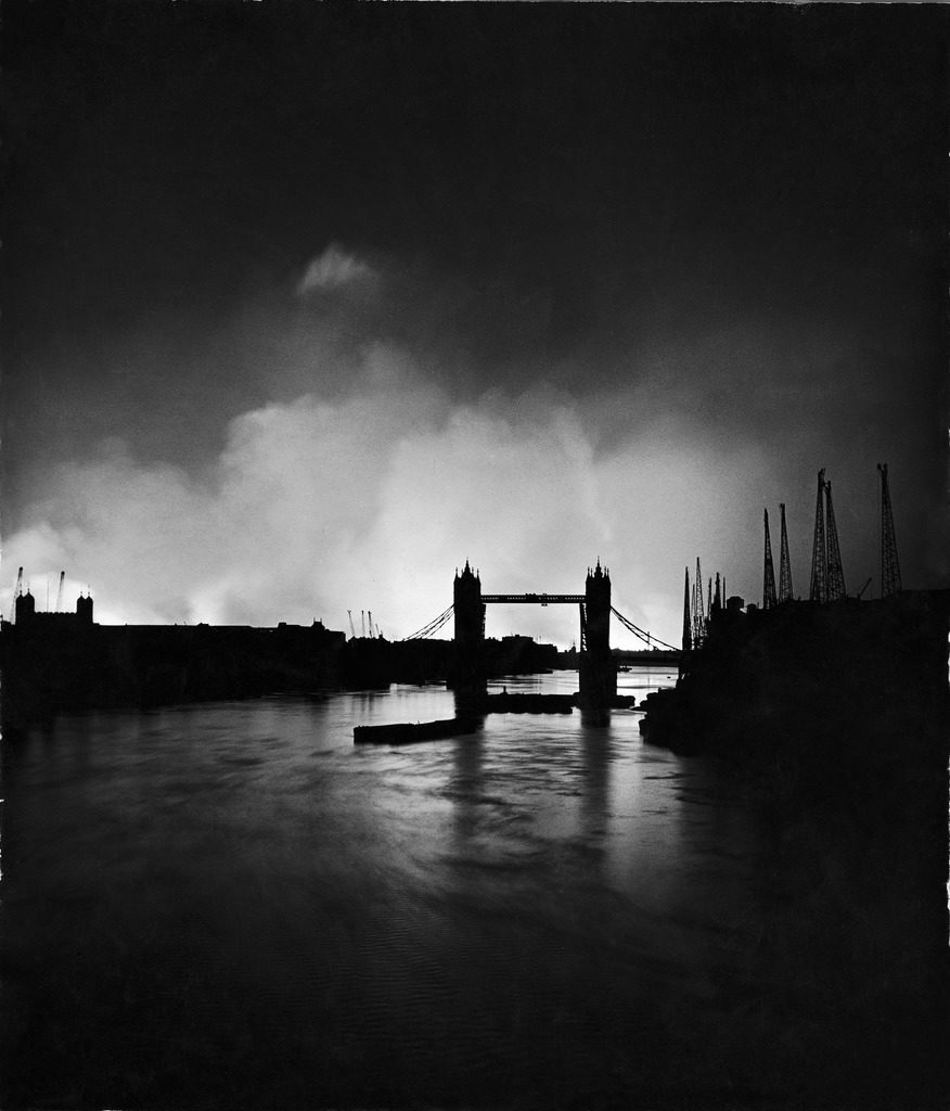 """""""False sunset"""" during the Blitz, with Tower Bridge silhouetted against burning docks, London, 1940. (Photo by William Vandivert/The LIFE Picture Collection © Meredith Corporation)"""