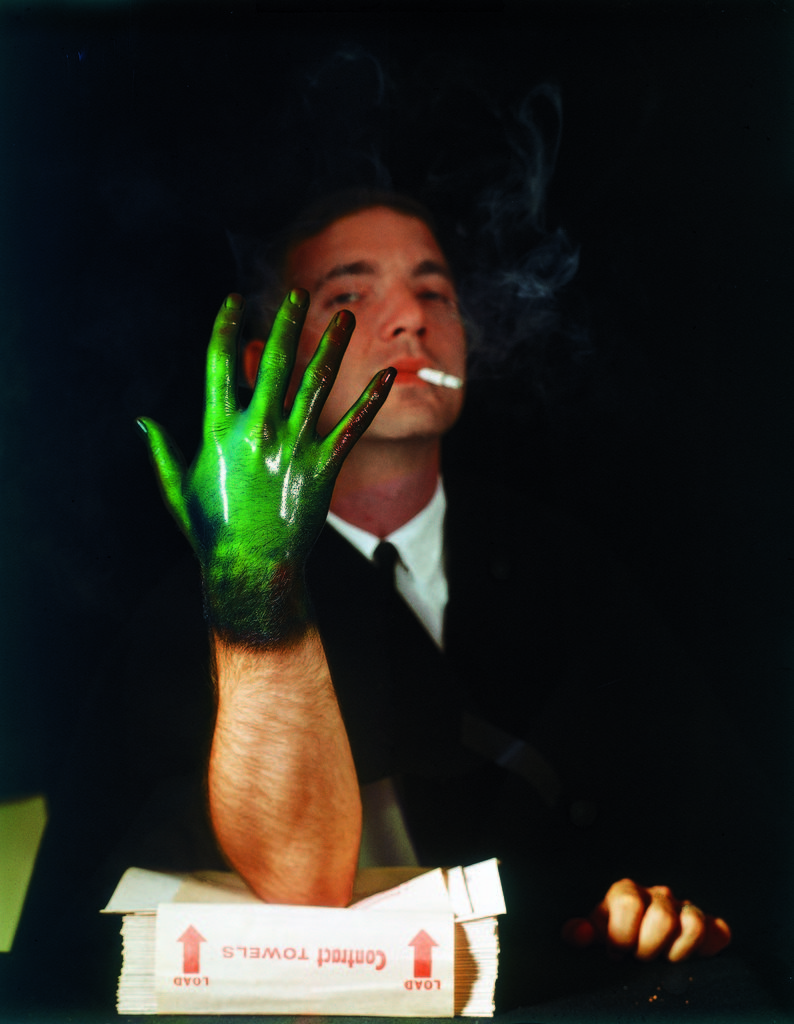 Man displaying his hand, coated with temperature sensitive liquid crystals, revealing decreased blood circulation (green coloration), a result of nicotine in cigarette smoke. (Photo by Henry Groskinsky/The LIFE Picture Collection © Meredith Corporation)