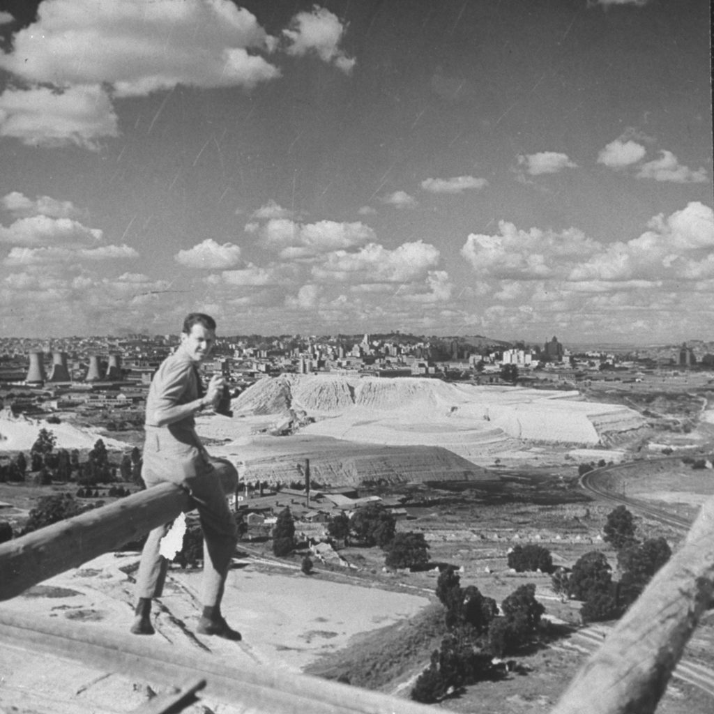 Preston Hart sitting on a cannon overlooking the city of Johannesburg, South Africa. (Photo by Hart Preston/The LIFE Picture Collection © Meredith Corporation)
