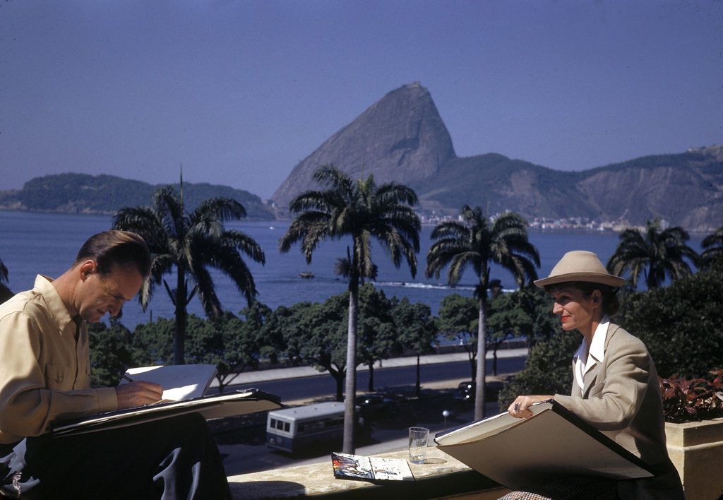 American movie producer, artist, and animator Walt Disney and fellow artist and animator Mary Blair sit on a balcony and draw on sketch pads while in South America. (Photo by Hart Preston/The LIFE Picture Collection © Meredith Corporation)