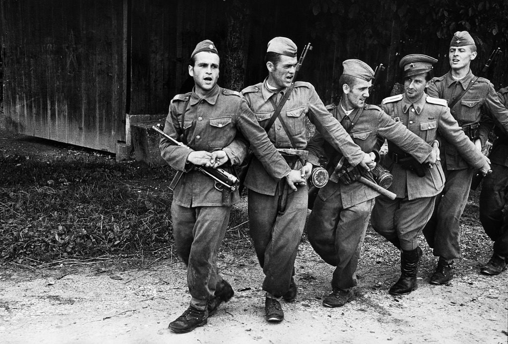 Yugoslavian infantrymen and an officer dancing the conga-like Kolo while singing. (Photo by John Phillips/The LIFE Picture Collection © Meredith Corporation)