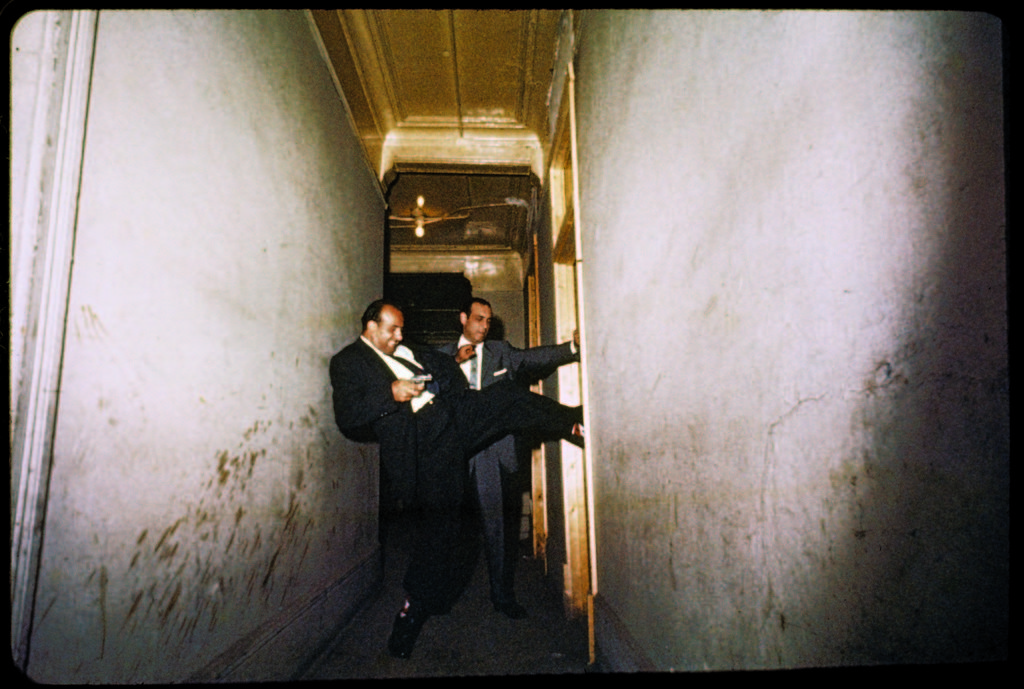 Detectives forcing their way into a suspicious room. (Photo by Gordon Parks/The LIFE Picture Collection © Meredith Corporation)