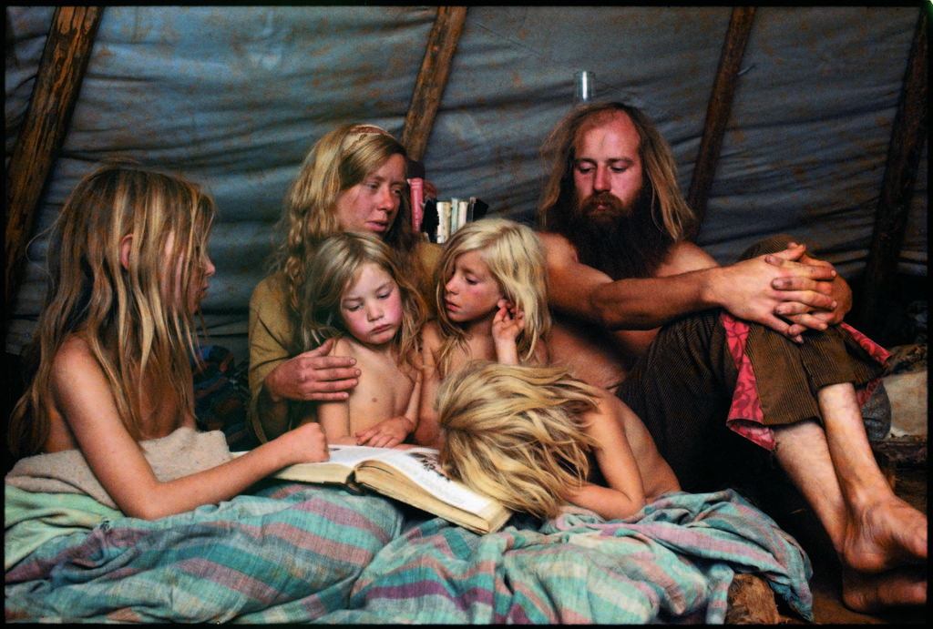 Tent-dwelling hippie family reading bedtime stories. (Photo by John Olson/The LIFE Picture Collection © Meredith Corporation)