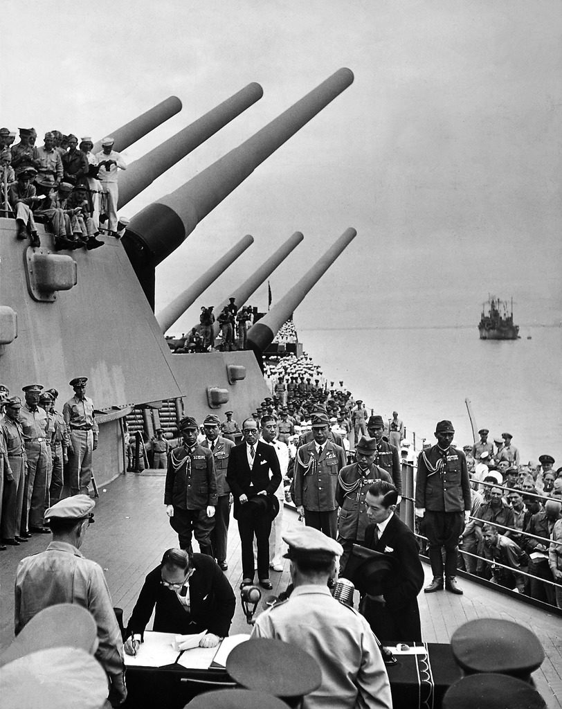 Allied officers and crew crowd the decks of US battleship Missouri. (Photo by Carl Mydans/The LIFE Picture Collection © Meredith Corporation)
