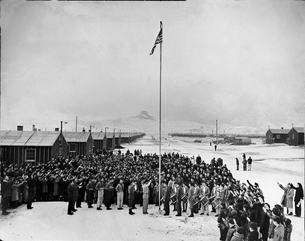 Nisei Japanese-Americans participating in a flag saluting ceremony at relocation center in forced internment during WWII. (Photo by Hansel Meith/The LIFE Picture Collection © Meredith Corporation)