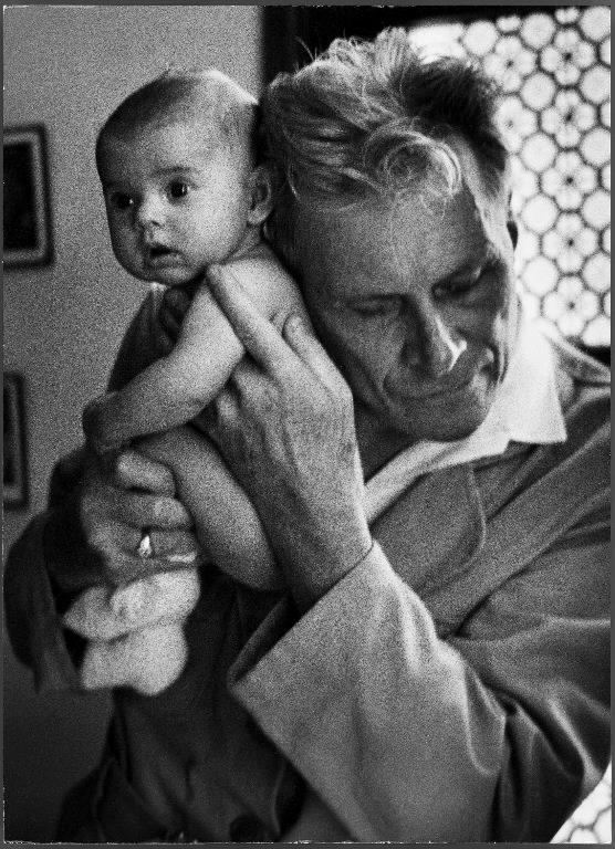 Blind doctor Albert A. Nast holding his ear to the back of a 3 month old instead of using a stethoscope. (Photo by Thomas McAvoy/The LIFE Picture Collection © Meredith Corporation)