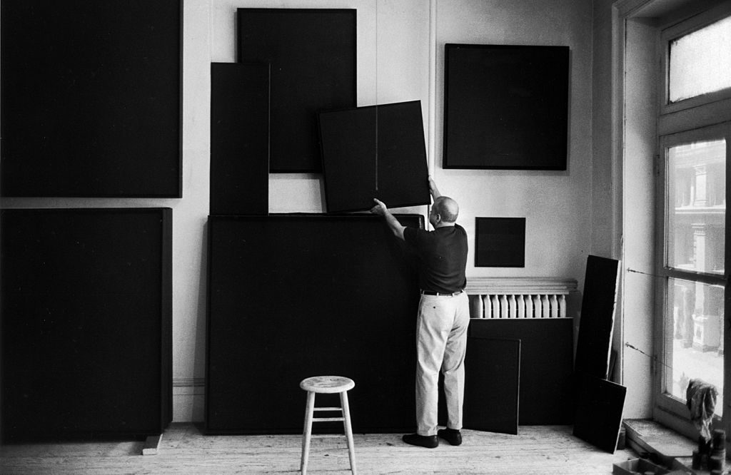 American artist Ad Reinhardt hangs his paintings to dry in a studio, New York, New York, 1966.(Photo by Michael Mauney/The LIFE Picture Collection © Meredith Corporation)