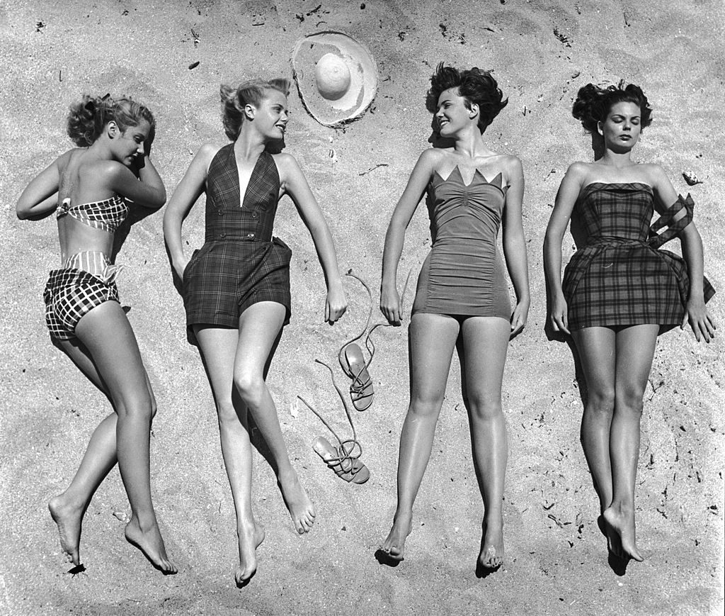 Models lying on beach to display bathing suits. (Photo by Nina Leen/The LIFE Picture Collection © Meredith Corporation)