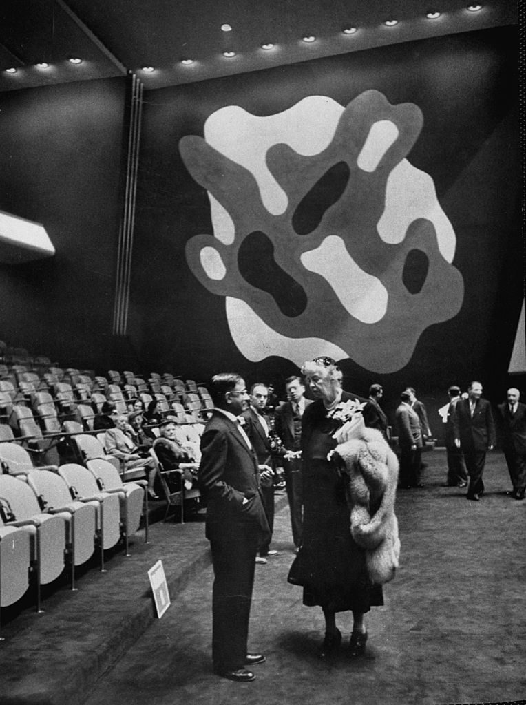 Eleanor Roosevelt talking to another UN delegate near a mural by artist Fernand Leger, 1952. (Photo by Lisa Larsen/The LIFE Picture Collection via © Meredith Corporation)