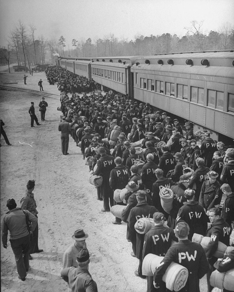 A new group of POW's arriving at the Eustis Railroad for POW's to begin their orientation program during WWII. (Photo by Walter B. Lane/The LIFE Picture Collection © Meredith Corporation)