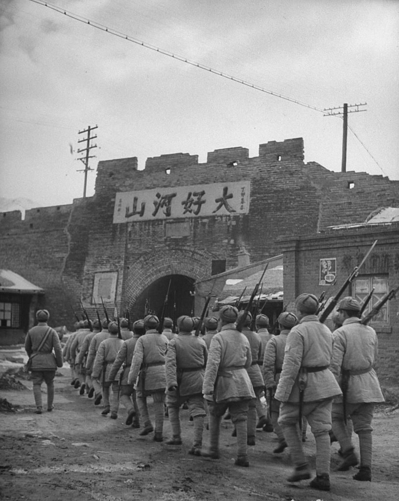 Communist soldiers marching through gates of Great Wall, 1946. (Photo by George Lacks/The LIFE Picture Collection © Meredith Corporation)
