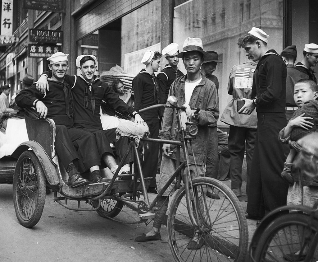 American sailors on shore leave sit in a pedicab while their buddy takes their picture, Shanghai, China, December 1945. (Photo by George Lacks/The LIFE Picture Collection © Meredith Corporation)