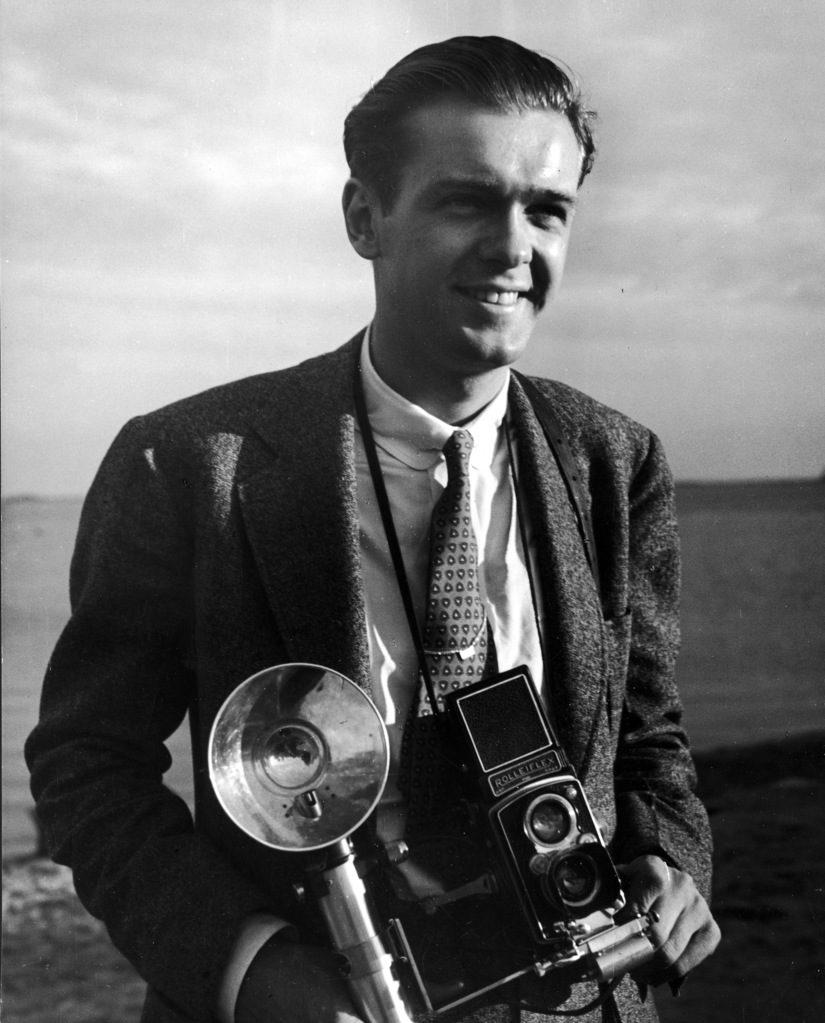 Portrait of photographer Walter B. Lane with his camera around his neck. (Photo by Alice Heidel /The LIFE Images Collection)