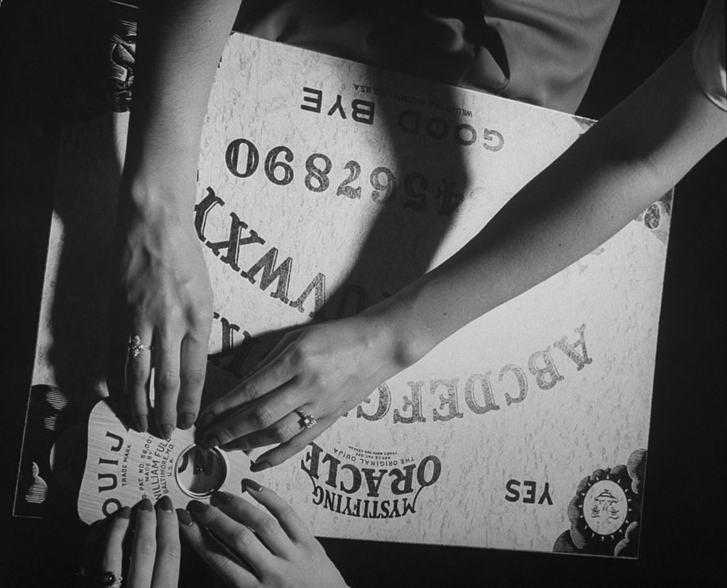 People playing with a Ouija Board. (Photo by Wallace Kirkland/The LIFE Picture Collection © Meredith Corporation)