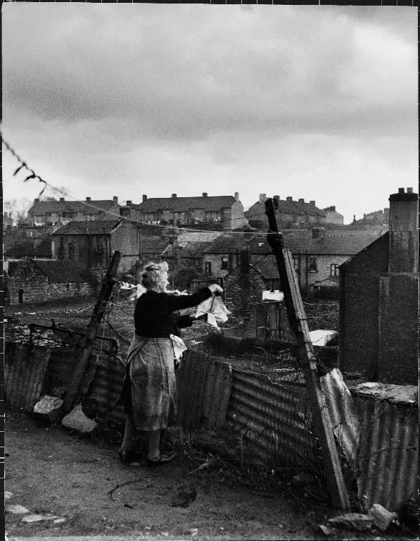 Woman hanging wash in a Dublin slum. (Photo by Anthony Linck/The LIFE Picture Collection © Meredith Corporation)