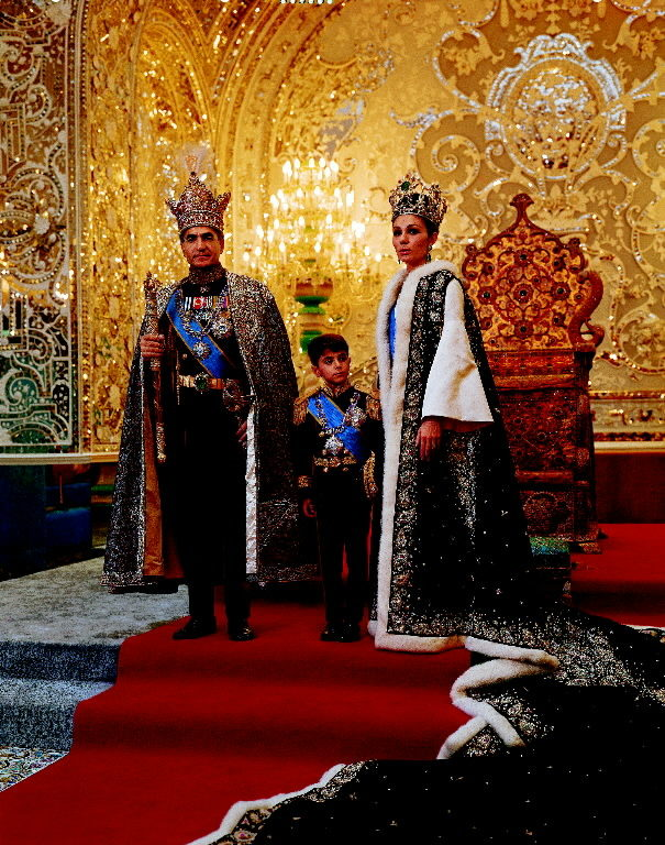 Shah of Iran, Mohamed Reza, posing with son Prince Reza and wife Farah wearing crown jewels and embroidered robes during coronation. (Photo by Dimitri Kessel/The LIFE Picture Collection © Meredith Corporation)