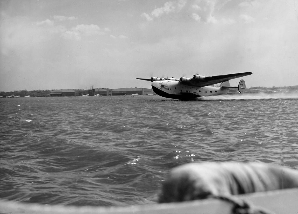 Pan American Clipper passenger plane skimming the surface of water during take-off of 23-hour transatlantic flight to Lisbon, Portugal. (Photo by Bernard Hoffman/The LIFE Picture Collection via © Meredith Corporation)