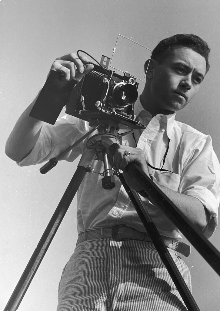 Photographer Rex Hardy Jr lines up a shot with his tripod -mounted camera, December 1937. (Photo by Alexander King/The LIFE Picture Collection © Meredith Corporation)