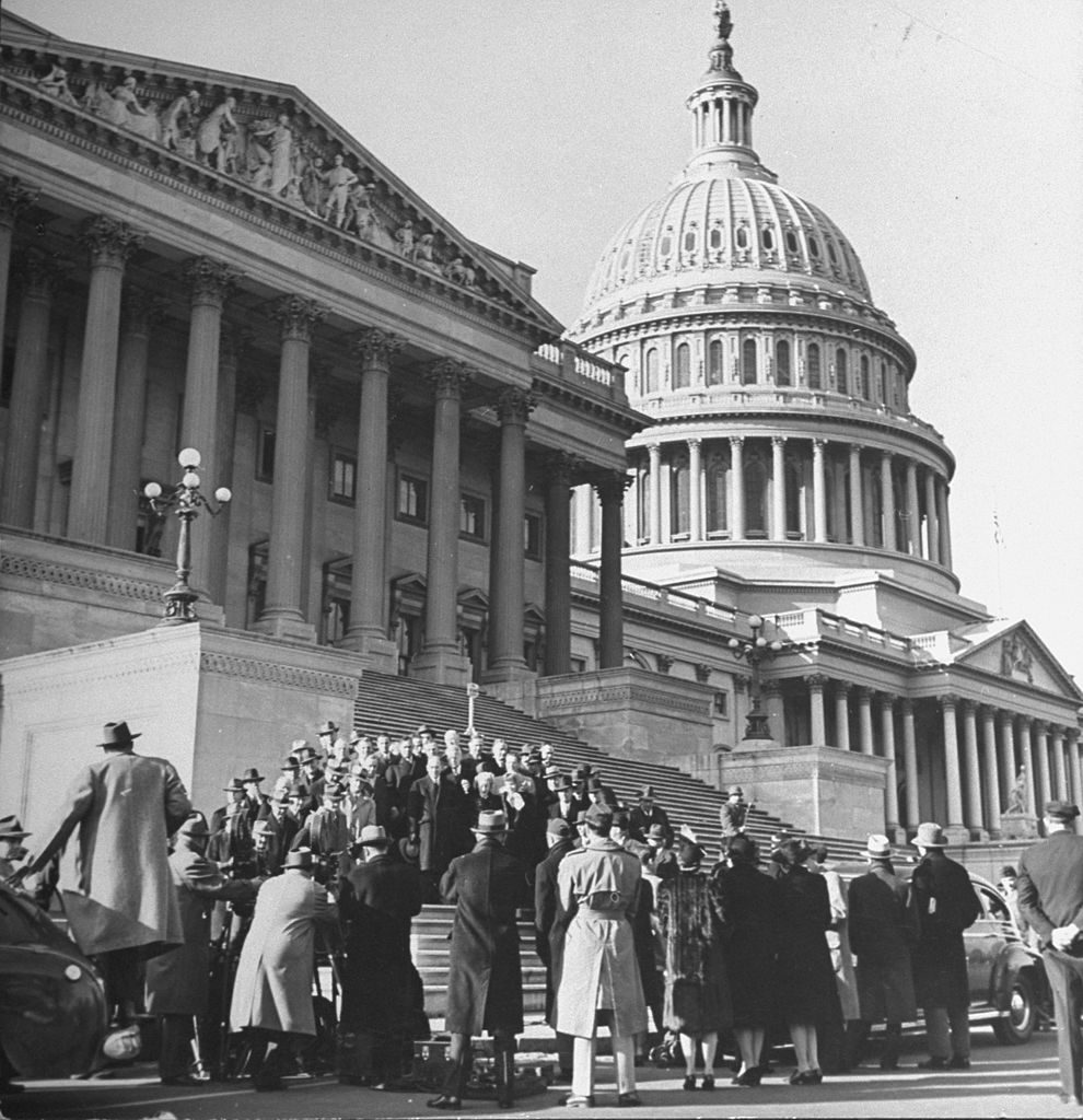 Congressmen posing on the front steps of the Capitol Building. (Photo by Marie Hansen/The LIFE Picture Collection © Meredith Corporation)