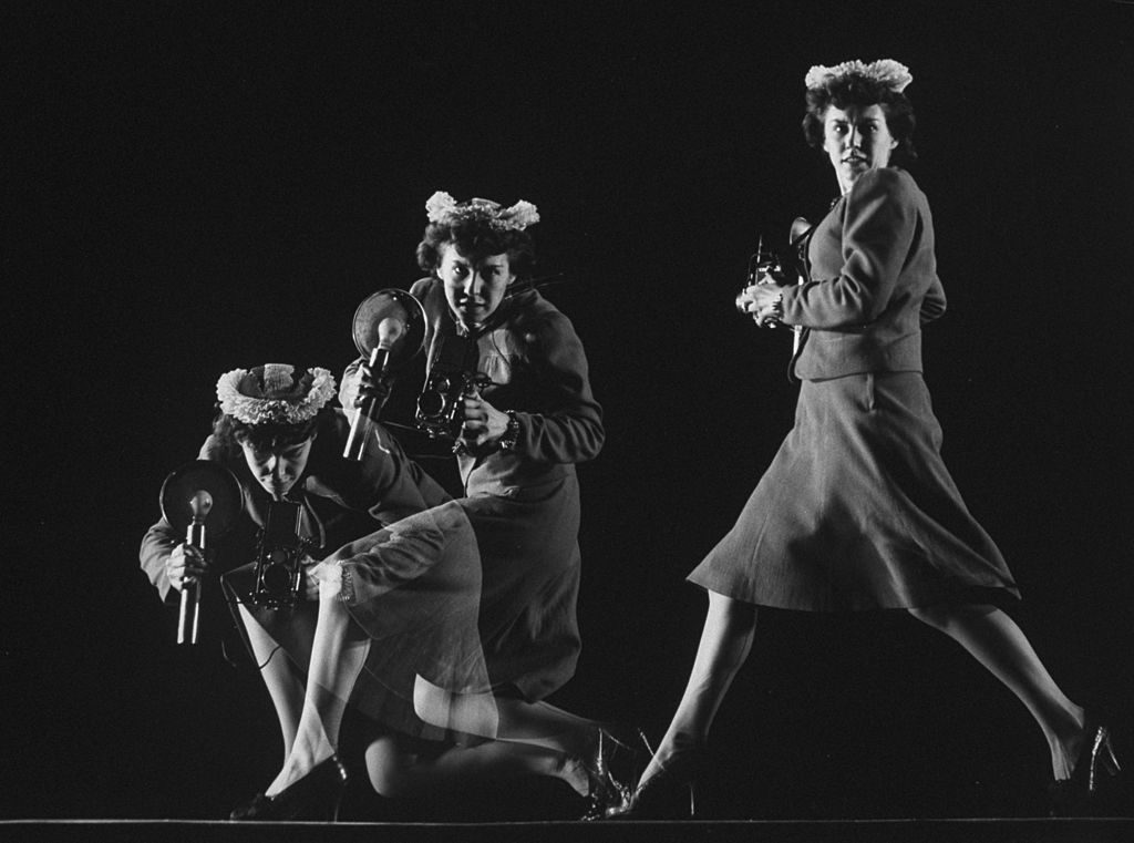 Multiple exposure photograph of LIFE photographer Marie Hansen handling a camera, running & crouching as she would do on assignment. (Photo by Gjon Mili/The LIFE Picture Collection © Meredith Corporation)